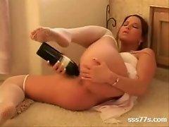 masturbating wth a bottle of wine